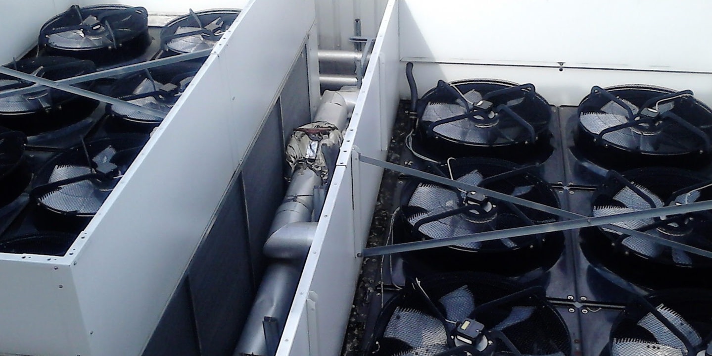 Packaged chiller service maintenance and repair showing the top of the chiller fan decks