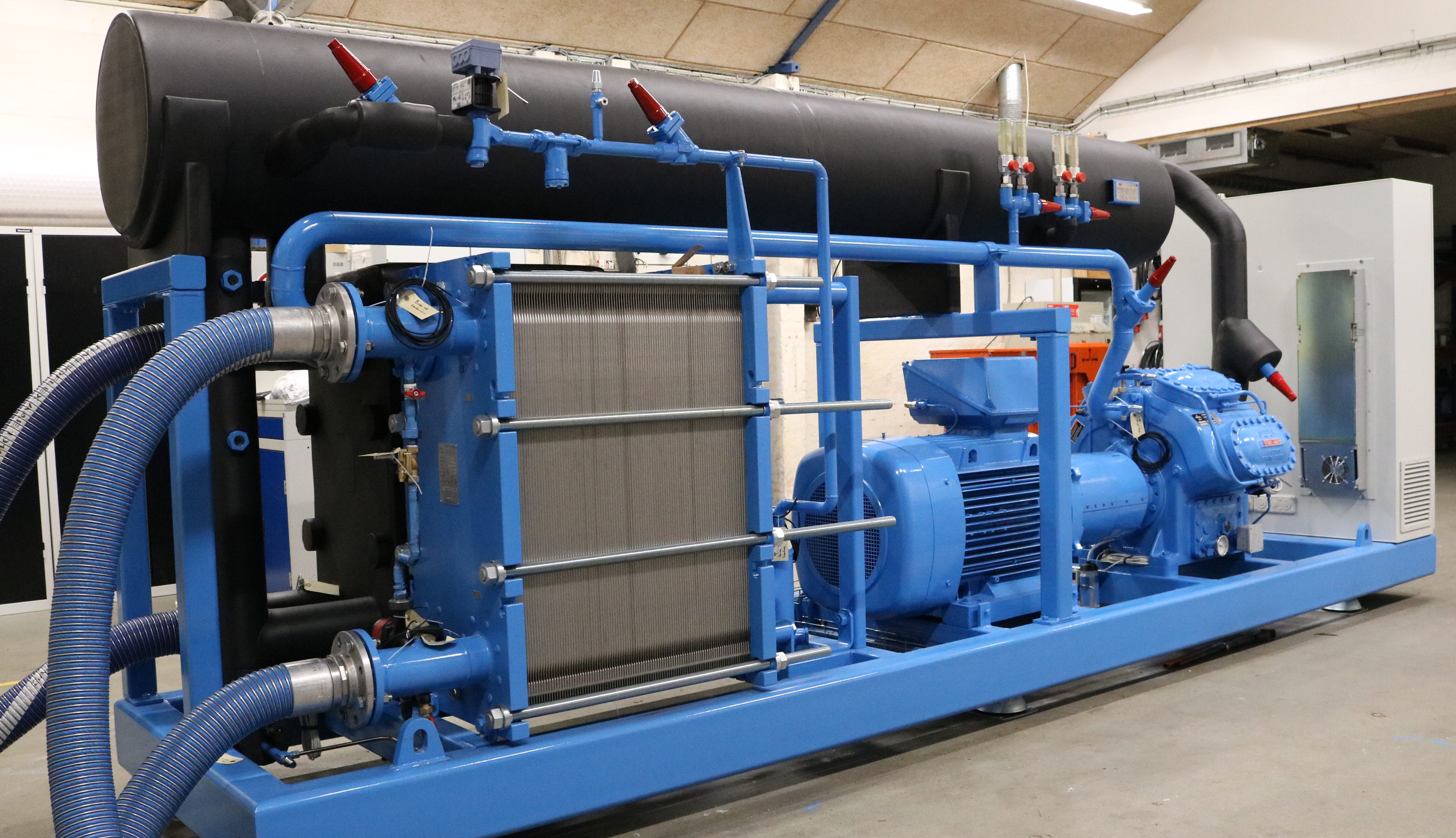 Water cooled ammonia chiller with black evaporator lagging for service, maintenance and repair