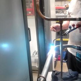 Leak Repairs showing engineer with oxy-acetylene torch
