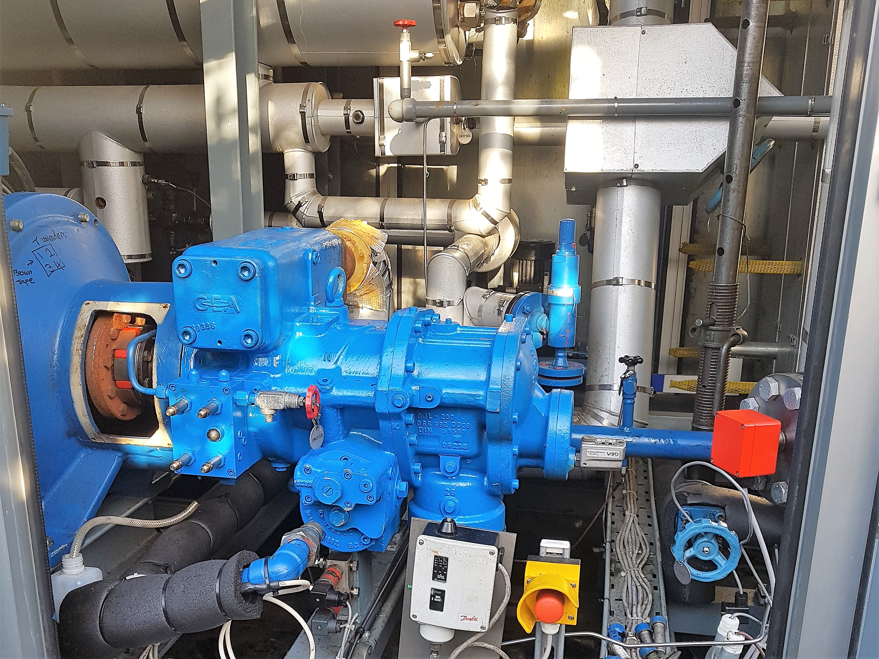 Blue Grasso industrial refrigeration compressor inside chiller being prepared to be lifted out