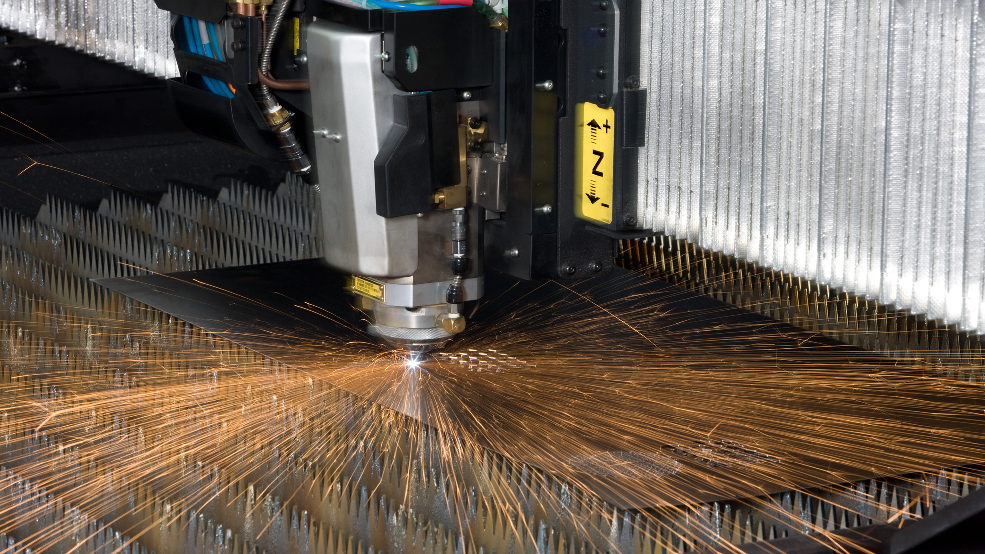 Laser chiller service maintenance and repair showing laser head and molten metal splash