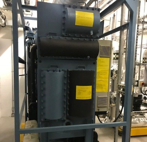 Green absorption chiller with black lagging for the cold parts of the system