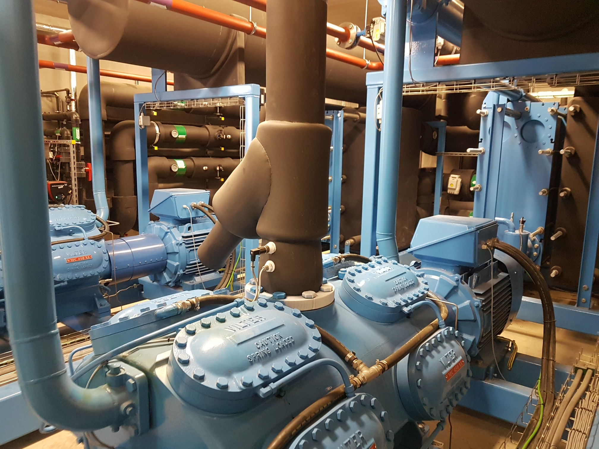 Machine room with blue and black glycol chillers during service maintenance and repair