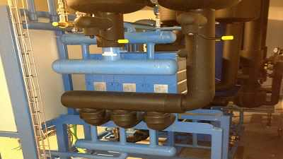 CO2 chiller blue pipework and black lagging