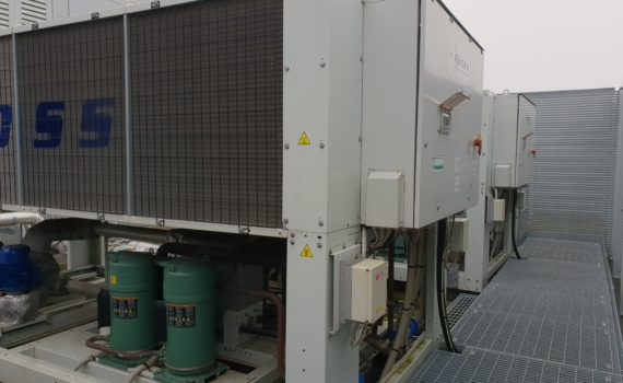 Air cooled chiller maintenance of two white chillers with green compressors