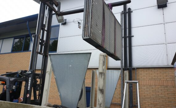 A chiller condenser retrofitting lifting operation outside in the compound