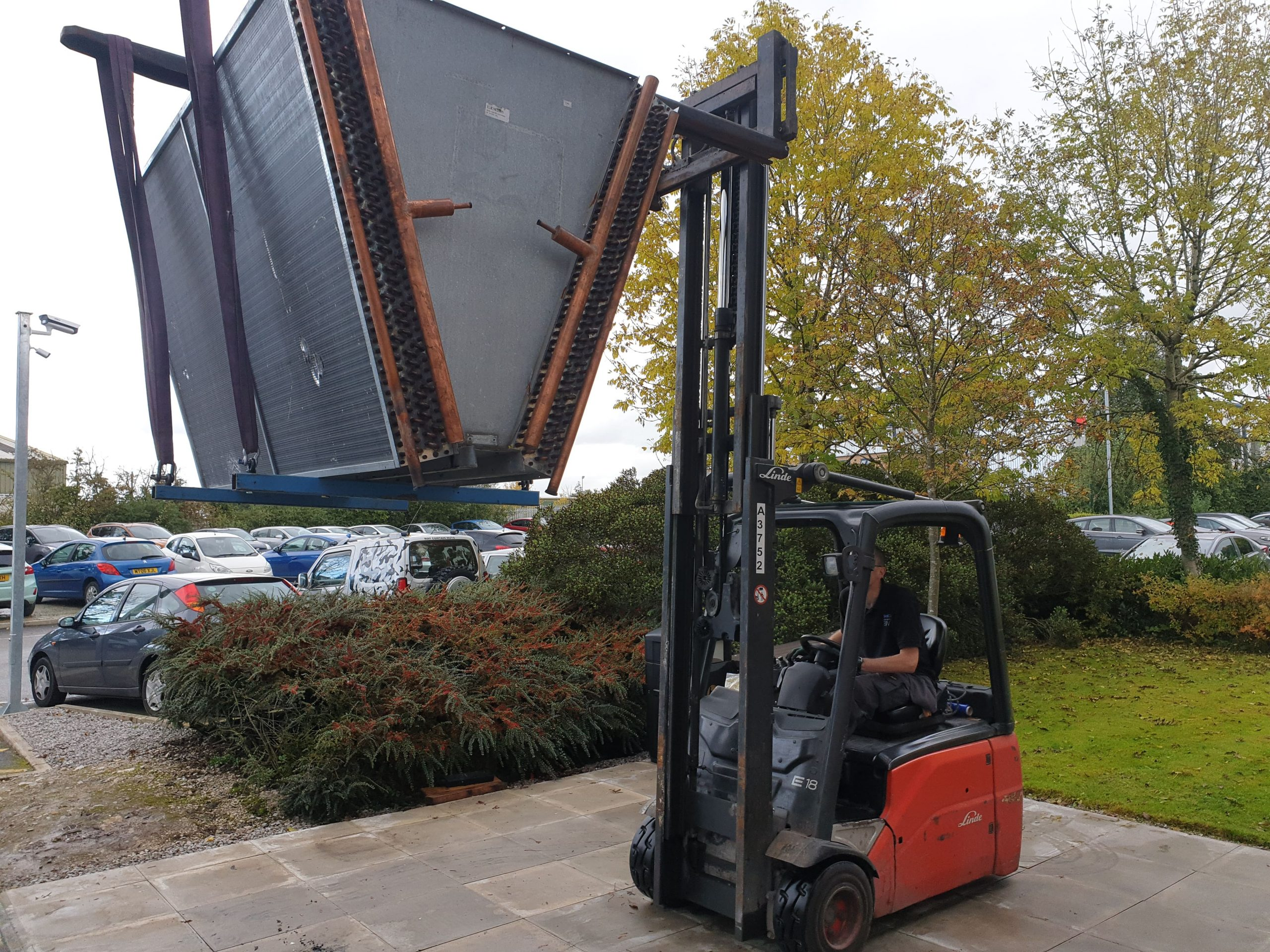 Chiller retrofitting of a bespoke 'v' type condenser being lifted into place with a forklift truck