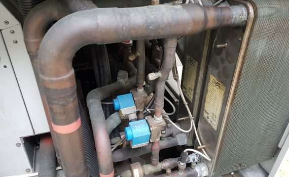 Air cooled chiller planned maintenance showing both economizers with solenoid valves and expansion valves
