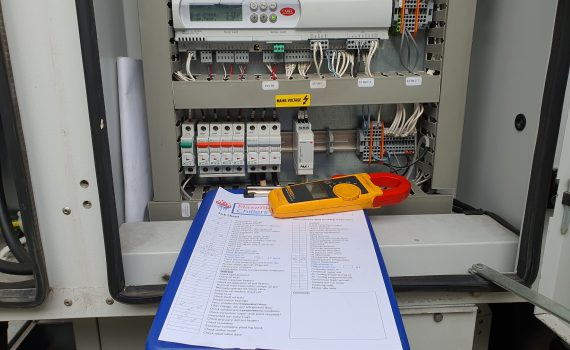 Carel controller and tick sheet during chilling plant maintenance visit