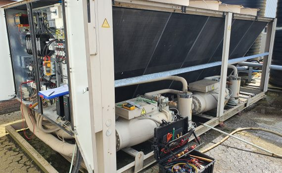 Large air cooled brown chiller with test equipment during planned preventative chiller maintenance