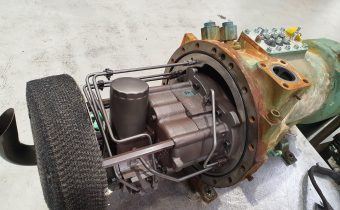 Green Bitzer screw chiller compressor with oil separator removed on bench in our workshop