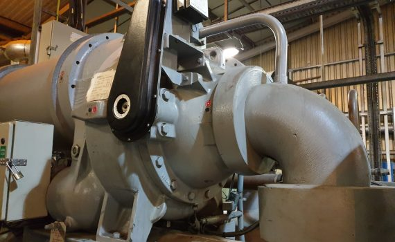 Grey centrifugal chiller compressor being maintained