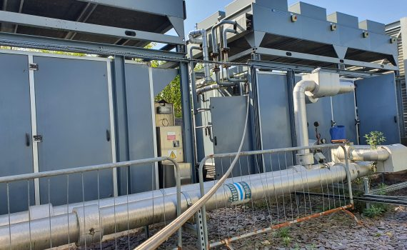 Example of chiller types: 2 grey containerised ammonia chillers with air cooled condensers on top
